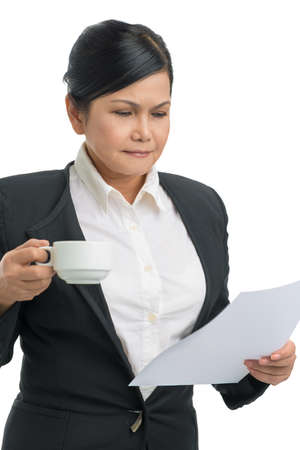 Portrait of a businesswoman holding a document and a cup