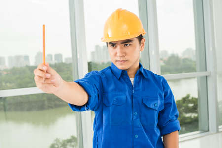 concentrated: Close-up of a concentrated industrial worker concentrated at measuring