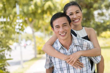 romantics: Copy-spaced portrait of a piggybacking couple outside Stock Photo
