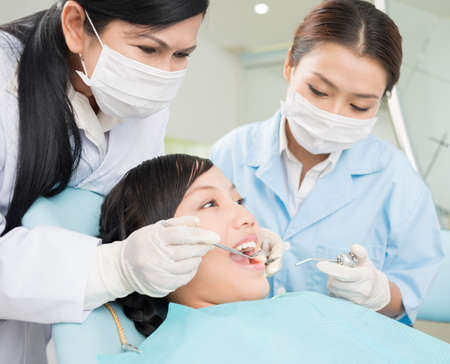 Image of a teenager having dental procedure in the clinic Stock Photo