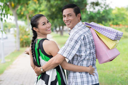 Portrait of a cheerful mature couple after shopping with shopping-bags