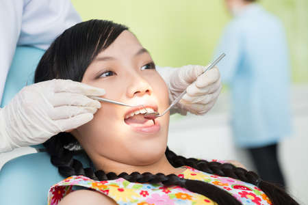 scaler: Close-up of a teenager having oral examination in the dental clinic Stock Photo