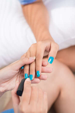 brash: Process of doing manicure close-up