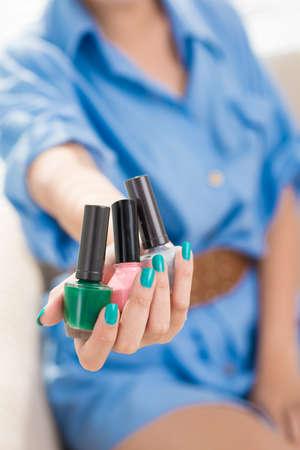 nailpolish: Close-up of a female hand giving nailpolish