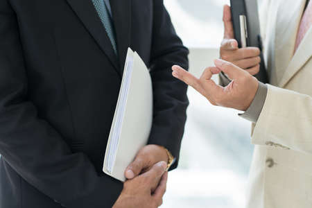 argumentation: Close-up of male hands gesturing while the discussion