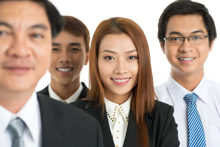 cutouts: Young business team looking at camera isolated