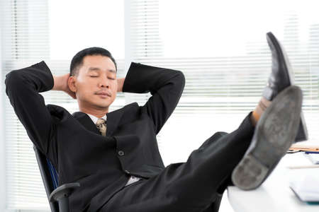 eyesclosed: Portrait of a tired businessman relaxing at office