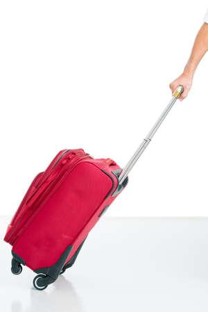 Immagine isolata di un bagaglio di trasporto della mano umana