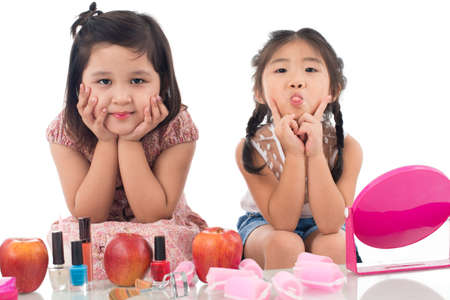 Isolated portrait of two little girls having fun together