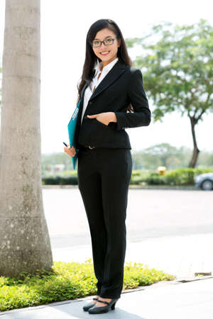 Portrait of a young elegant business lady outdoors Stock Photo