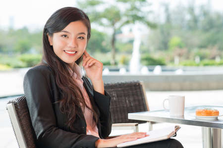 asian businesswoman: Portrait of a young businesswoman having lunch at a cafe