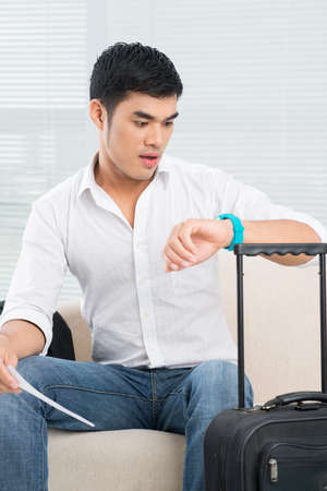 being the case: Excited man looking at his watches being late