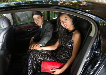 Portrait of a luxury young couple sitting in a car Stock Photo