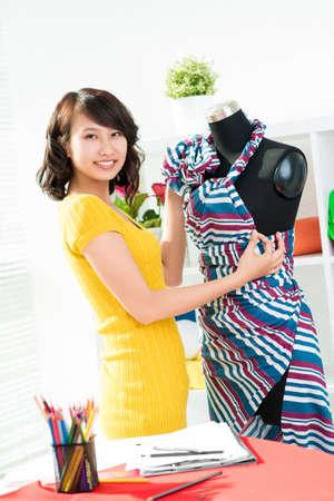 dressmaker: Portrait of a young dressmaker looking at camera