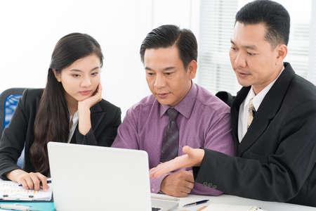 argumentation: Business team solving working problems together