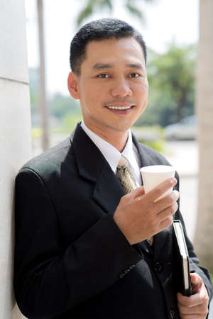 coffeecup: Portrait of a businessman with coffee-cup