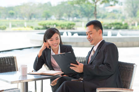 argumentation: Businesspeople at a cafe solving problems Stock Photo