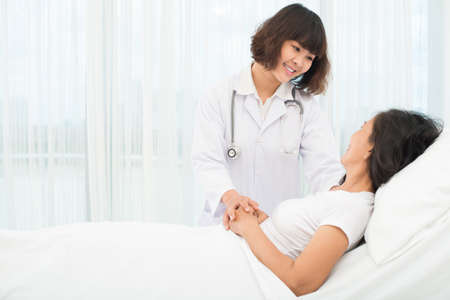 Copy-spaced image of a young nurse girl comforting the mature patient in the hospital