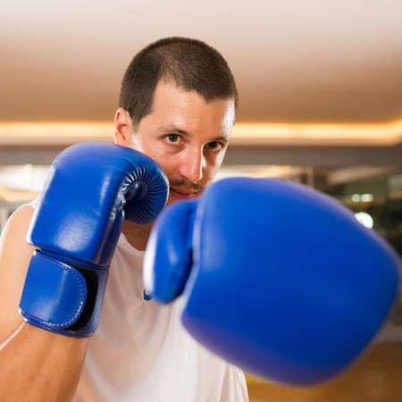 Portrait of punching boxer Stock Photo