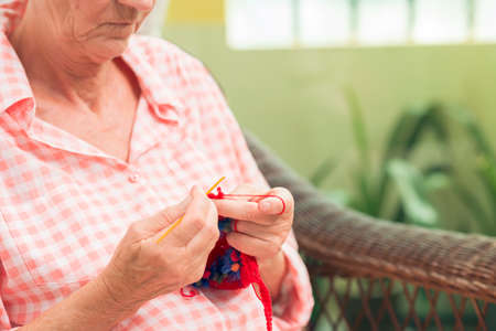 occupied: Close-up of a senior woman being occupied with knitting