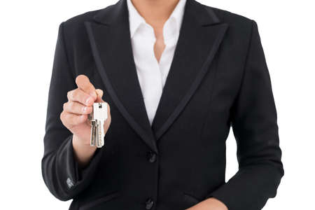 Cropped image of a realtor showing the keys from the new apartment isolated on white