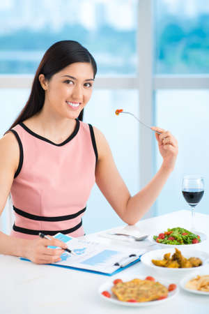 Vertical portrait of a young lady on a business lunch  Stock Photo