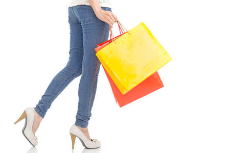 shoppingbag: Cropped image of a shopper with paperbags against a white background Stock Photo