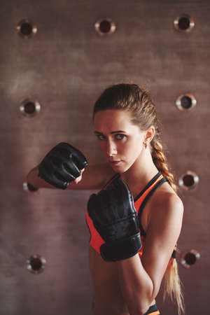 competitive sport: Portrait of young female boxer at training Stock Photo