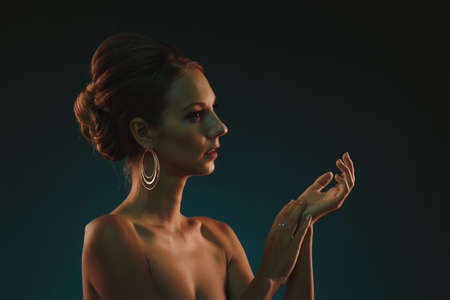 beautiful nude woman: Young beautiful elegant woman with evening hairstyle Stock Photo