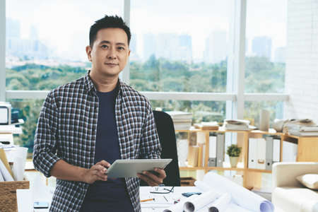 singaporean: Portrait of professional Singaporean architect with tablet computer Stock Photo