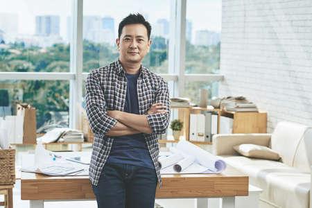 singaporean: Portrait of confident Singaporean architect standing in his bureau Stock Photo