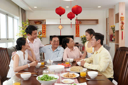 Big Vietnamese family gathered at Tet table
