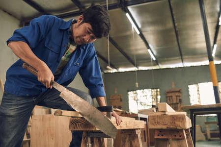 sawing: Sawing man