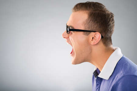 Profile of a furious man Stock Photo