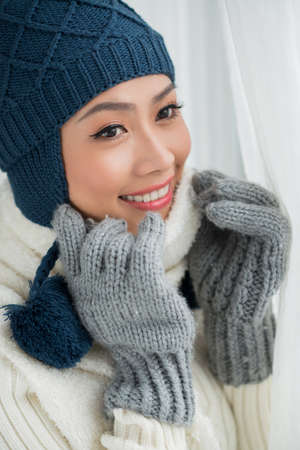 Close-up image of a young lovely woman in winter fashionable clothes
