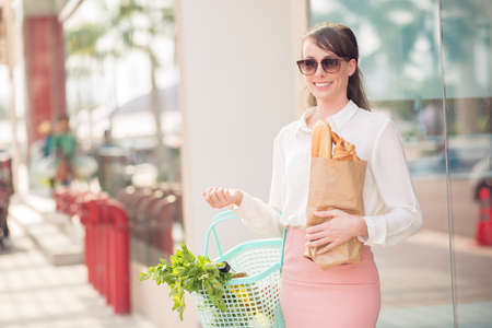 Copy-spaced portrait of a young glamorous lady after shopping in the grocery
