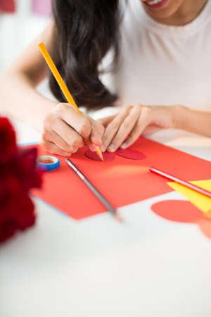 card making: Girl making Valentine cards