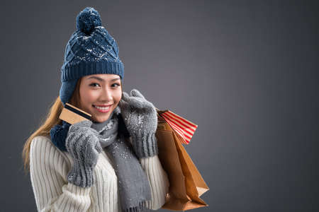 Copy-spaced portrait of a lovely shopaholic doing the winter shopping