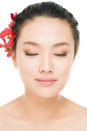 Vertical image of an eye-closed Asian young woman with smooth skin and natural make-up Stock Photo