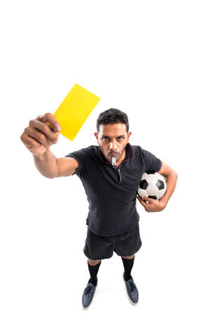 Referee holding a yellow card, view from above Stock Photo