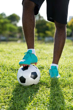 Footballer touching ball with his foot Stock Photo