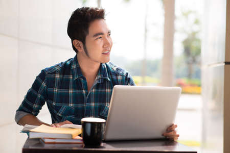 Closeup image of a student using modern technologies for the education on the foreground