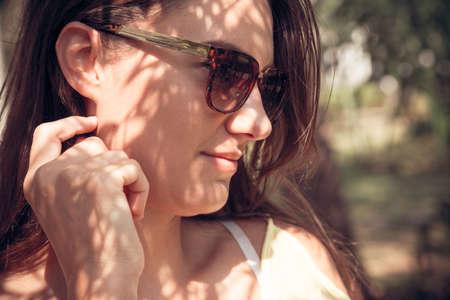 woman profile: Profile of woman in sunglasses Stock Photo
