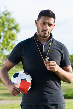 Portrait of soccer coach standing outdoors