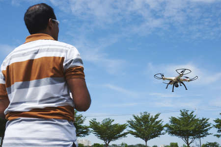 Man focused on playing with drone