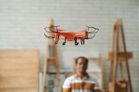 indoors: Small quadcopter flying indoors Stock Photo