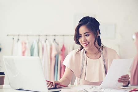 woman work: Pretty fashion designer