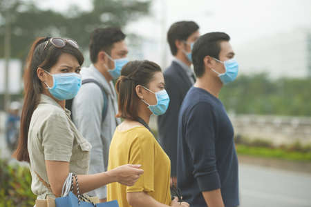 People wearing face masks beacuse of flue outbreak