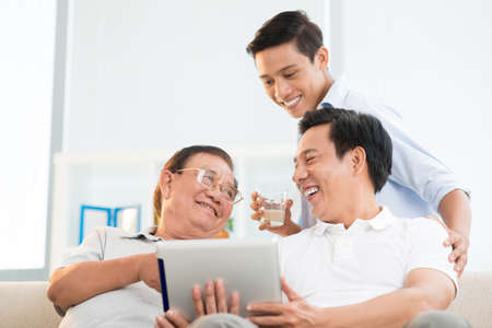 Angle view of a male family having fun at home on the weekend Stock Photo - 72844675