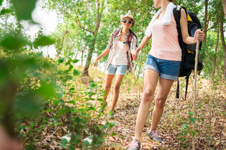 Young female hikers in the forest Stock Photo